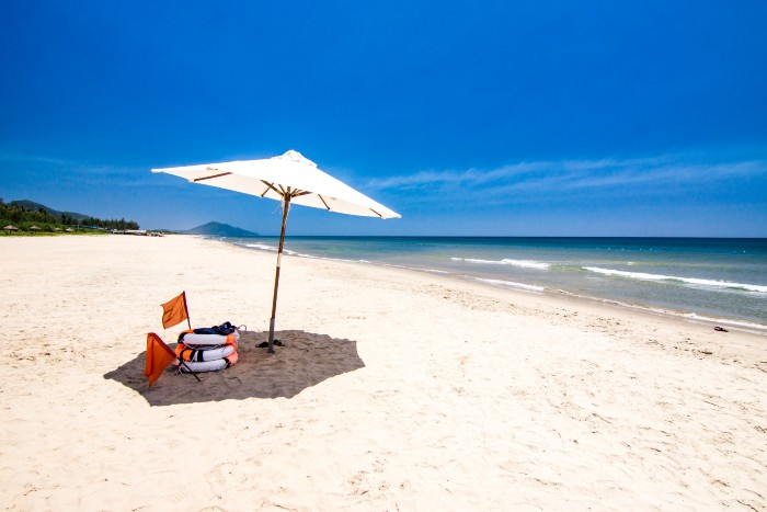 Hue: white sand beach of Lang Co with an umbrella
