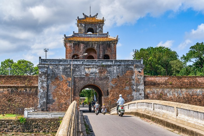 Hue: landmark in Hue with a man on a motorbike