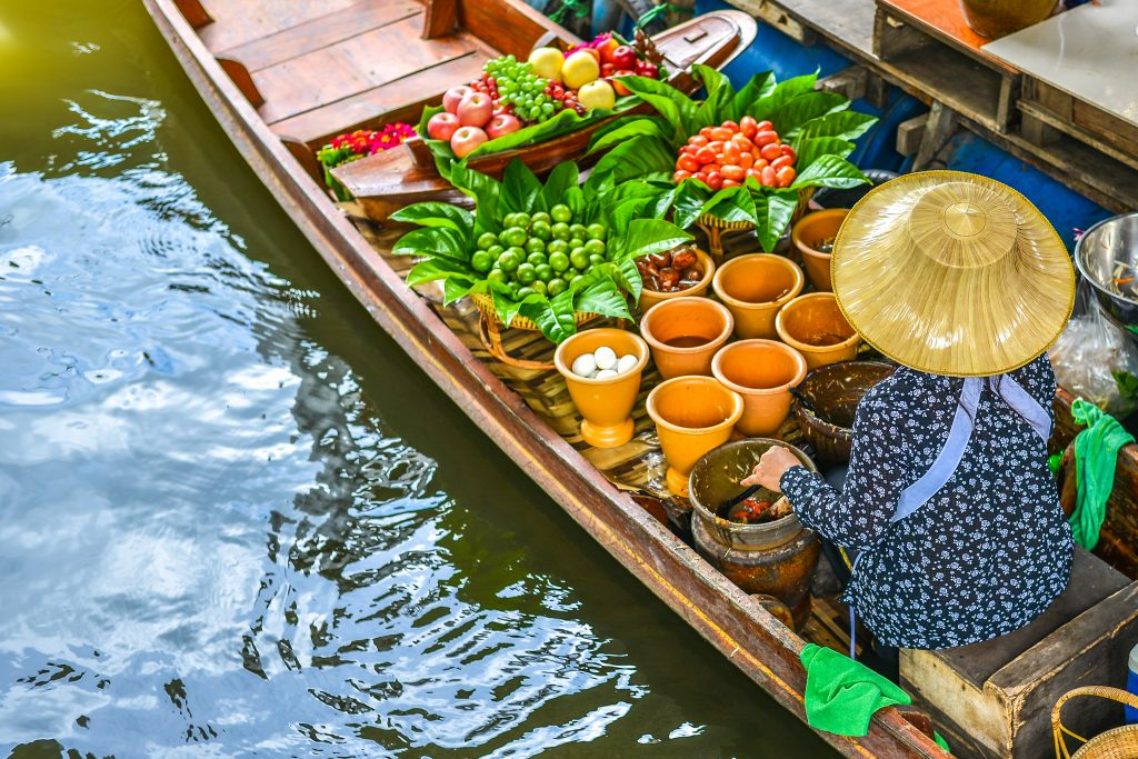 A wooden boat in the floating market
