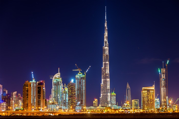Dubai: the Burj Khalifa from afar in the evening with lights on