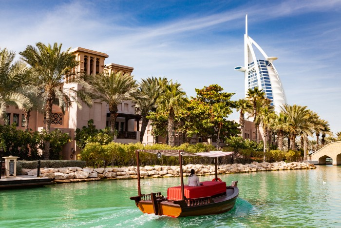 Dubai: view of the Burj Al Arab with a dhow passing by