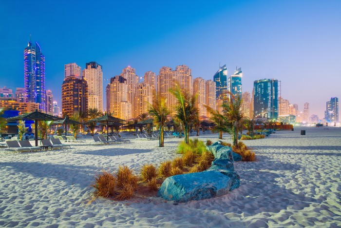 the sand and buildings that can be seen from Jumeirah Beach