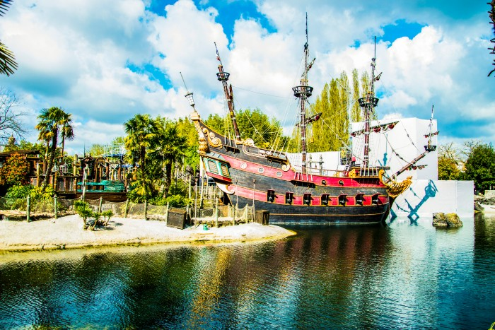 Pirate ship docked on an island in Disneyland Paris
