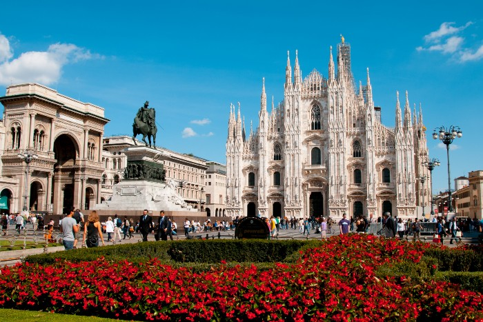 Milan: The Duomo with beautiful red flowers on its foreground