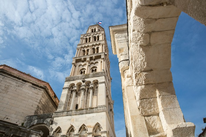 Split: a worm's eye view of the bell tower against the blue skies