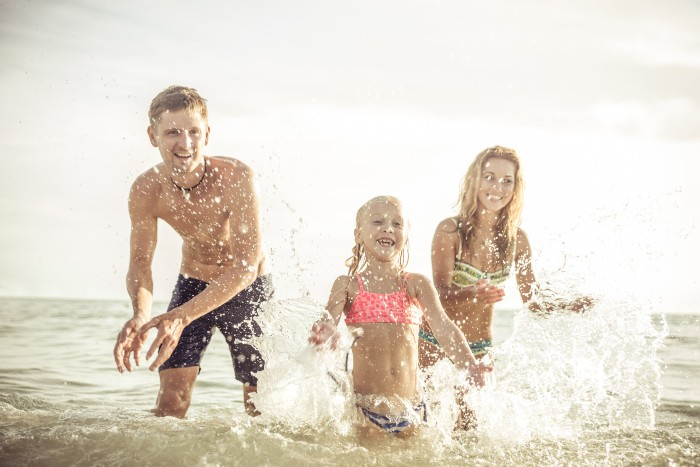 Split: three kids playing in the water