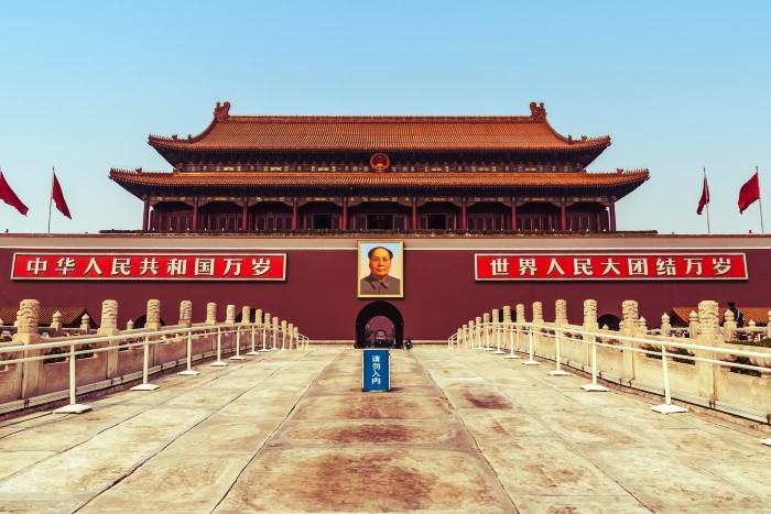 Beijing: Tiananmen Square with a photo of their leader