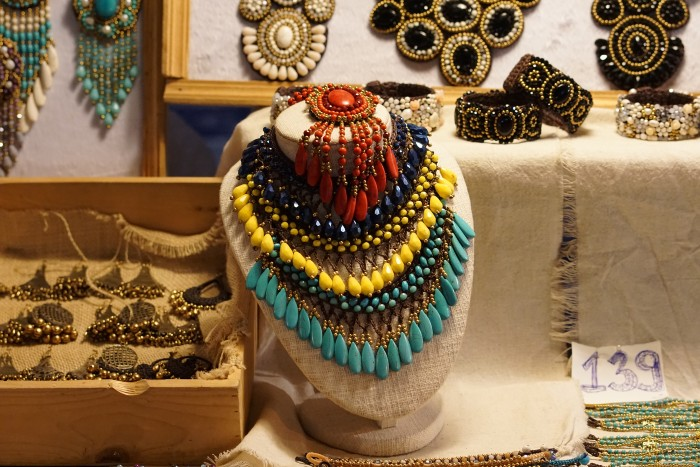 an intricately designed necklace on display