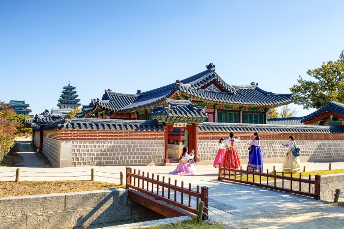 Seoul: an old palace with tradititonally-dressed girls walking by