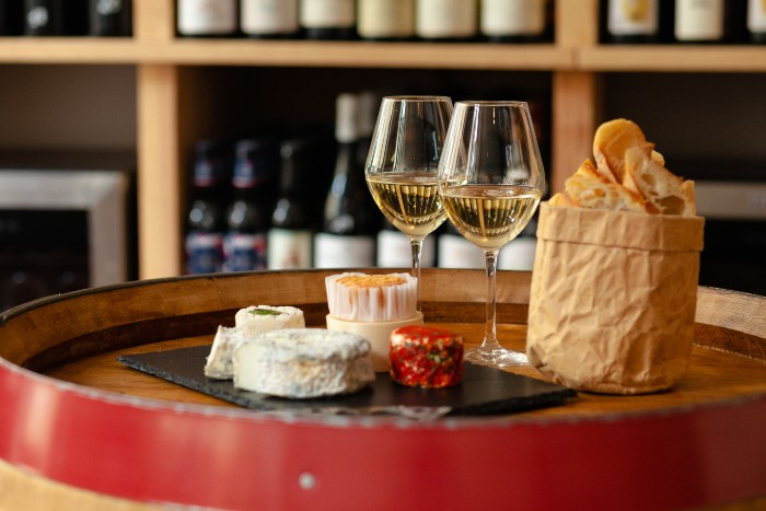 Paris: two glasses of wine with cheese on the table