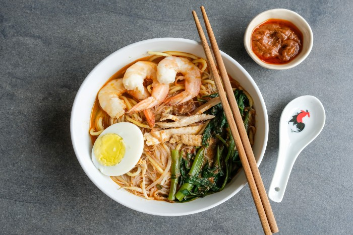 food lovers' guide to Singapore: noodle soup in a bowl with chopsticks
