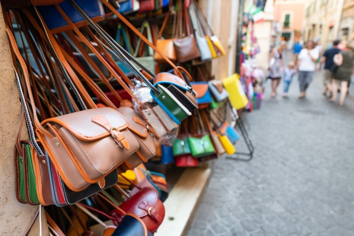 best times to visit Rome: bags hung for sale at the market